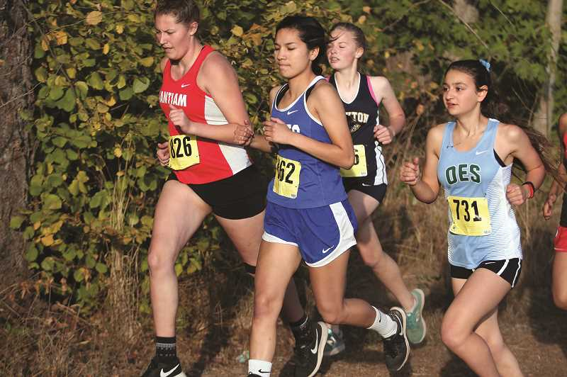 PMG FILE PHOTO: PHIL HAWKINS - Senior Jackie Diaz is the top returning runner for the girls team, which brings back experienced teammates like Stephanie Morales, Mayra Lozano and Abby Gonzalez.
