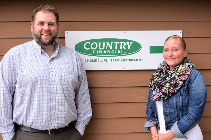 PMG PHOTO: EMILY LINDSTRAND - Cole Pritchard and Liz Dobbs of Country Financial appreciate serving the Sandy community.