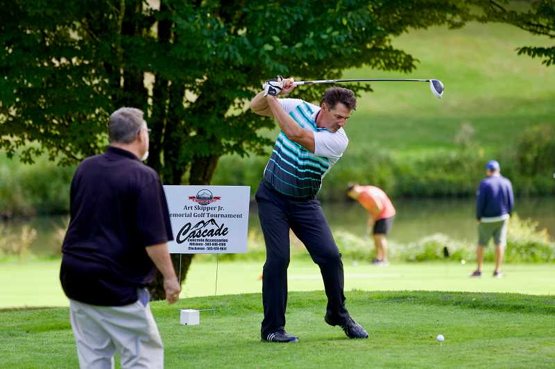 COURTESY PHOTO - A participant tees off during a previous Art Skipper Jr. Memorial Golf Tournament, a fundraiser for Sandy High Schools No Pioneer Left Behind program.