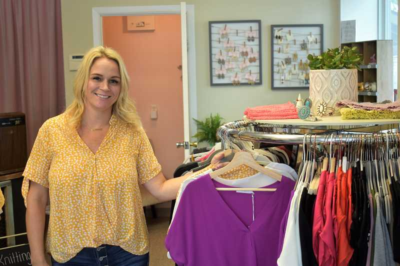 PMG PHOTO: EMILY LINDSTRAND - Nicole O'Malley offers a variety of apparel and accessories at her store, Nikki Lea. The boutique shares space with Black Sheep Yarn Co. at 28080 S.E. Highway 212, Boring.