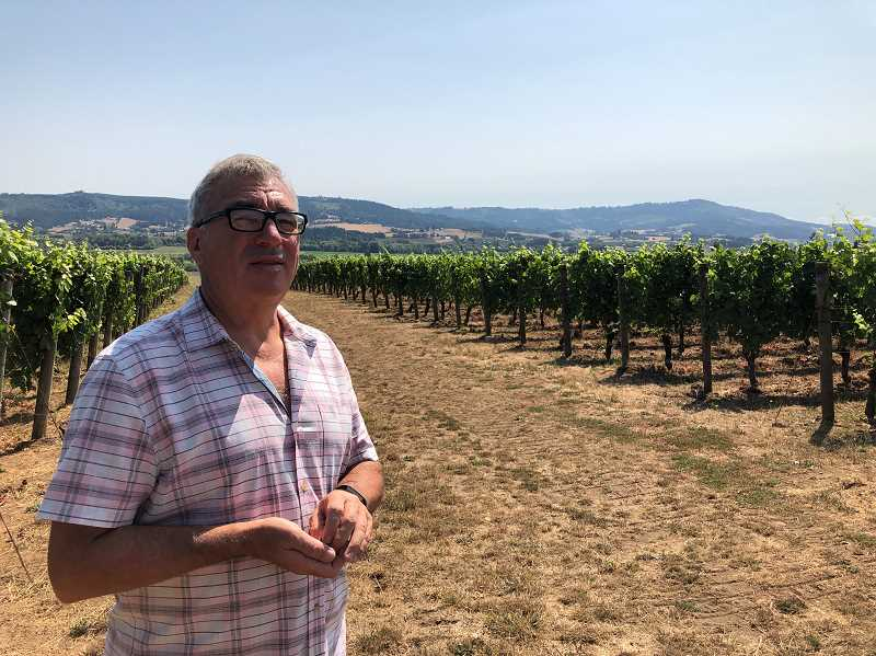 Monte Pitt is one of the owners of Patton Valley Vineyard in Gaston. He stands at the top of the vineyard with a great view of the valley.