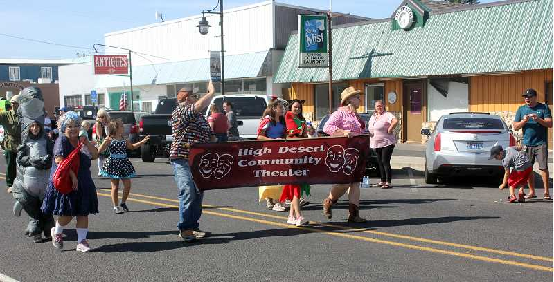 DESIREE BERGSTROM/ MADRAS PIONEER - The High Desert Community Theater Guild marches in the Culver Crawdad Festival parade on Saturday, Aug. 17, all wearing costumes as they smile and wave at spectators.