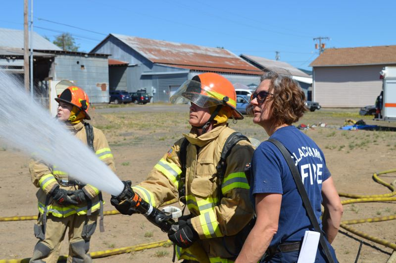 COURTESY PHOTO: CLACKAMAS FIRE - Clackamas Fire Capt. Melanie Kinne teaches classes July 21-22 for women interested in the profession at the first Fire-Up Bootcamp.