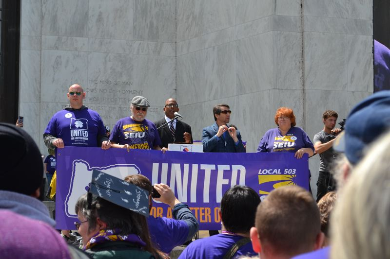 PMG FILE PHOTO - SEIU 503 members rallied outside the Capitol in late May during negotiations for a new state contract. University employees also are considering a strike because of stalled negotiations.