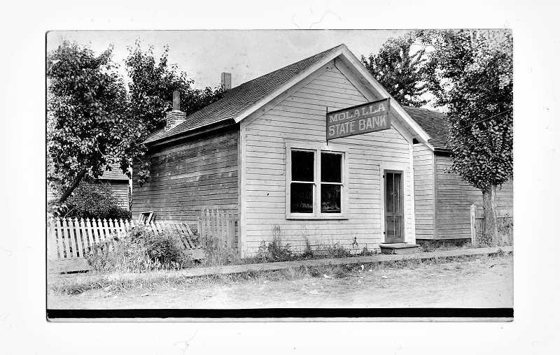 "COURTESY PHOTO: MOLALLA AREA HISTORICAL SOCIETY - The original Molalla State Bank building was a wood frame building in which the bank directors were said to have ""been compelled to remodel from an old woodshed for temporary quarters"".  It was in use from September of 1912 to September of 1913."