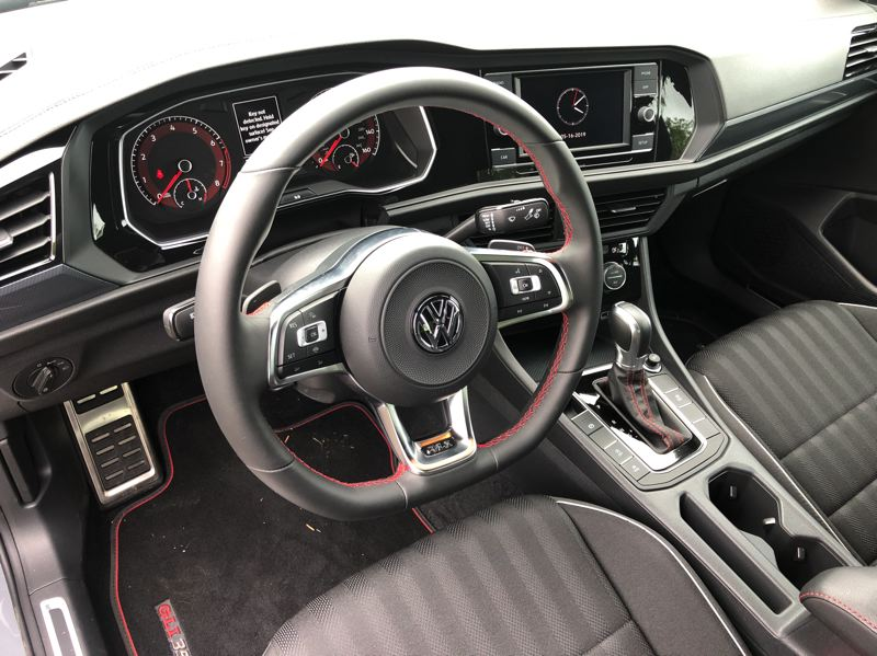 PMG PHOTO: JEFF ZURSCHMEIDE - The interior of the 2019 VW Jetta GLI features special red stirching and other trim, plus comfortable and supportive cloth sport buckt seats.