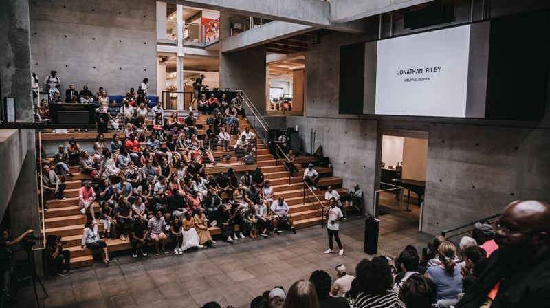 PHOTO: THE COLLAB.PDX, ALEX KNOWNODY - Jonathan Riley explains how Blaq Athlete could help young recruits be celebrated and rewarded rather than exploited and ignored, at Pitch Black at the Wieden + Kennedy atrium.