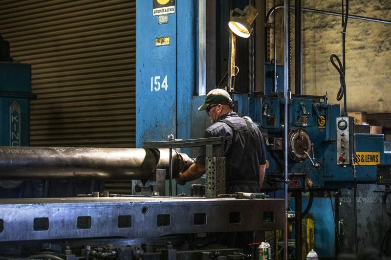 TRIBUNE PHOTO: JONATHAN HOUSE - By buying equiment product lines from other companies, Allied Systems has been able to keep high-wage skill labor jobs for machinists and welders in Oregon.