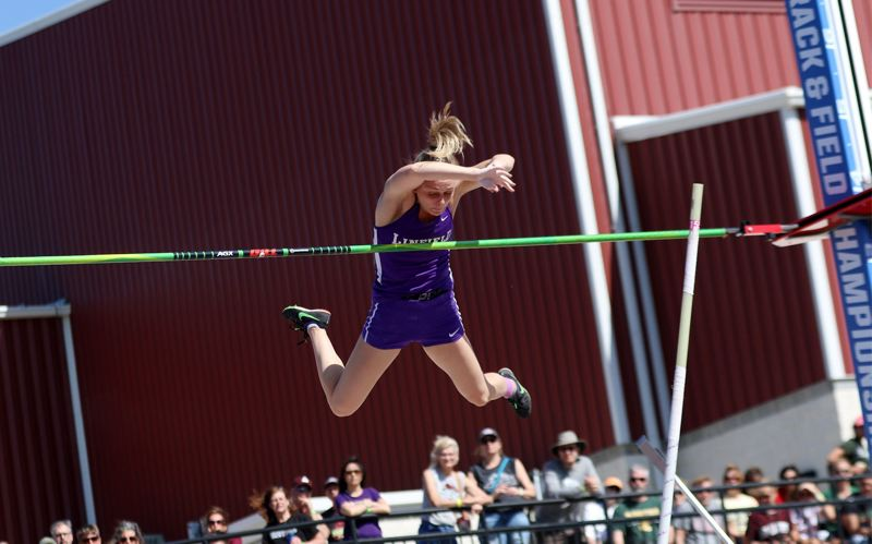 COURTESY: D3PHOTOGRAPHY.COM - Scappooses Olivia McDaniel clears the pole-vault bar on her way to winning the NCAA Division III championship outdoors this year for Linfield College.