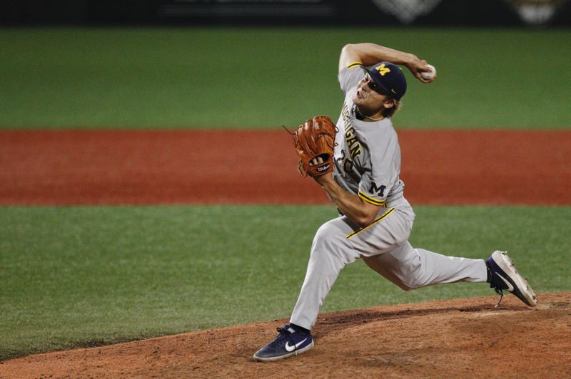 COURTESY PHOTO: UNIVERSITY OF MICHIGAN - Willie Weiss, whose baseball roots were in Scappoose, pitches as a freshman last season for the unsung Michigan Wolverines as they go all the way to the College World Series finals.