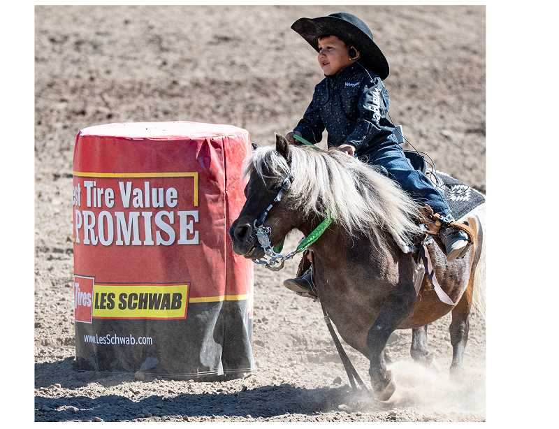 CENTRAL OREGONIAN FILE PHOTO - A youth barrel racer rounds the first barrel at last year's Paulina Amateur Rodeo. This year's rodeo is scheduled for Saturday and Sunday, Aug. 31, and Sept. 1. There are also activities at the Paulina Rodeo Grounds on Friday, Aug. 30.