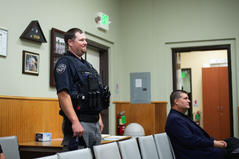 PMG PHOTO: ANNA DEL SAVIO - Chisum Ford, left, and James Macfarlane, right, were introduced to the Scappoose City Council at the council's Aug. 19 meeting.