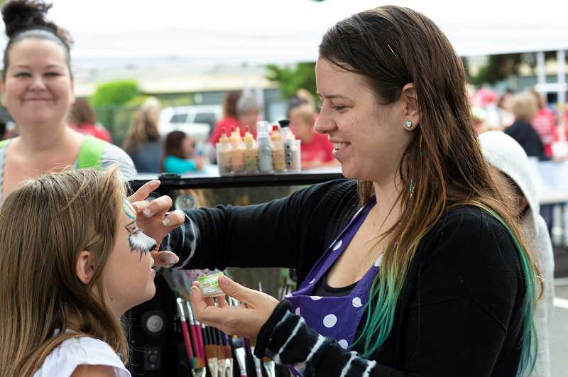 PMG PHOTO: CLARA HOWELL  - Shawna Thomas paints faces at the Gear up 4 School event.
