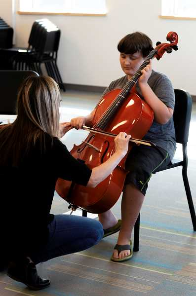 PMG PHOTO: CLARA HOWELL  - Blake Holder samples the orchestra instruments.