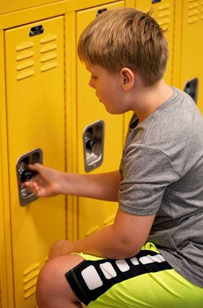 PMG PHOTO: CLARA HOWELL - Wyatt Windsheimer practices his locker combination prior to school starting.