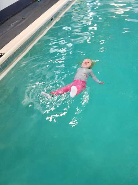 COURTESY PHOTO: BECCAH BJORN - Kirsten Bjorn's younger sister, Maija Bjorn, practices her free float on Friday, Aug. 23 at Swimbabes in Milwaukie.