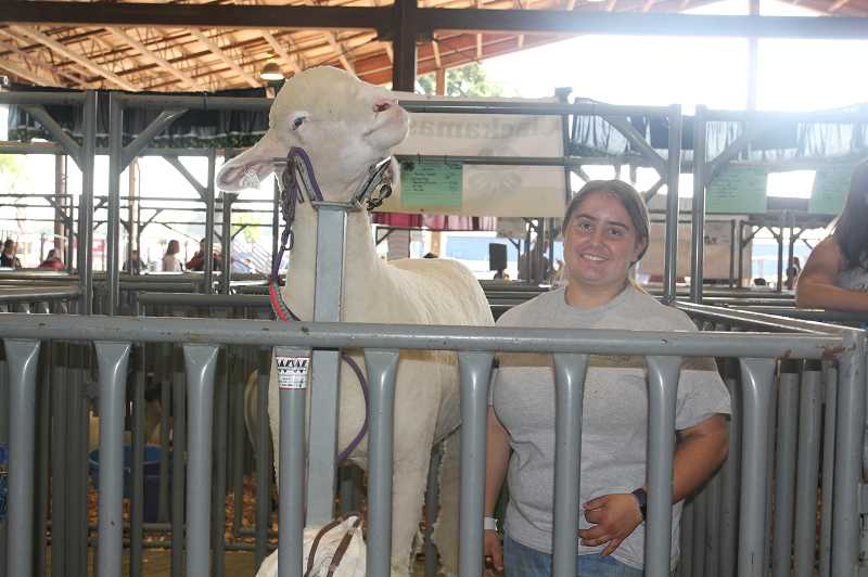 PMG PHOTO: JUSTIN MUCH - DresenFreschweiler of Gervaisposes with Marthaat the Oregon State Fair Friday, Aug. 23, 2019.Martha is one of 5 ovines she will be showing as member of Gervais FFA.