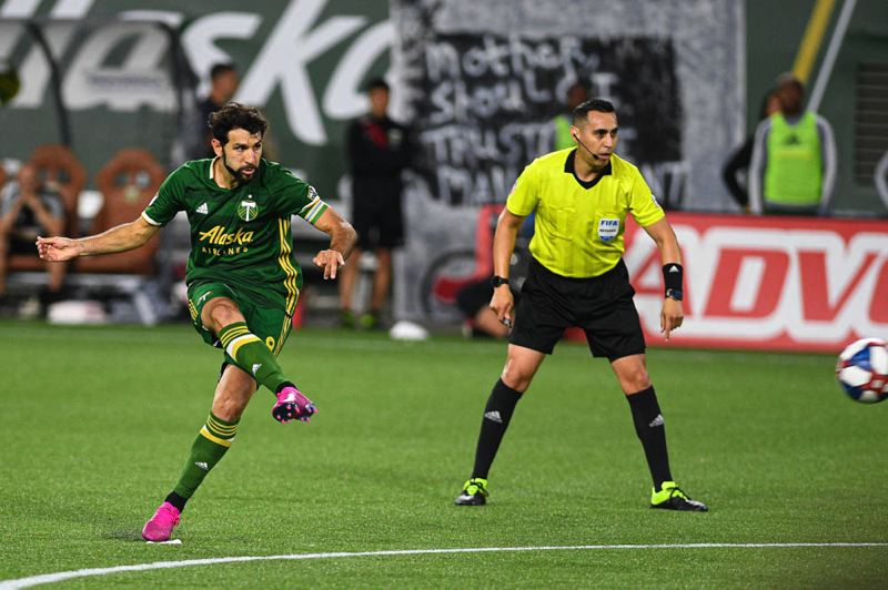 PMG PHOTO: CHRISTOPHER OERTELL - Diego Valeri of the Portland Timbers shoots during Friday night's game against the Seattle Sounders.
