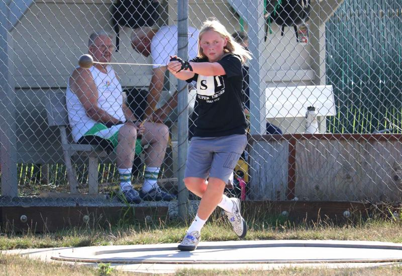 PMG PHOTO: JIM BESEDA - Tualatin's Madison Speer, an eighth-grader at Hazelbrook Middle School, threw a personal best of 122-0 in the girls hammer throw during Friday's Super Thrower Track Club meet in Oregon City.