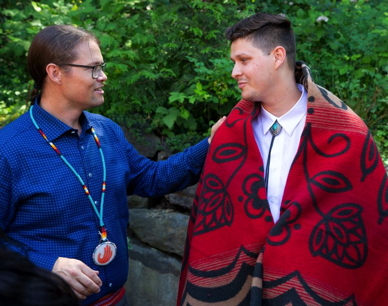 COURTESY PHOTO: OHSU/MICHAEL SCHMITT - Dr. Erik Brodt, left, talks with Jacob Smith at the Wyeast Post-Baccalaureate Pathway graduation ceremony in June at PSU's Native American Student Community Center.
