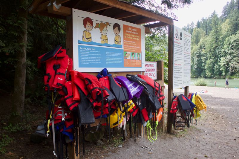 PMG PHOTO: CHRISTOPHER KEIZUR - The life jacket station at Oxbow Regional Park on the Sandy River is well stocked, but swimmers at the boat ramp beach on a recent weekday werent using them.