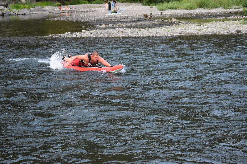 PMG PHOTO: SHANNON O. WELLS - Dan Johnson, an American Medical Response rescue technician, is quick to hit the water to check on swimmers safety at Glenn Otto Community Park in Troutdale.