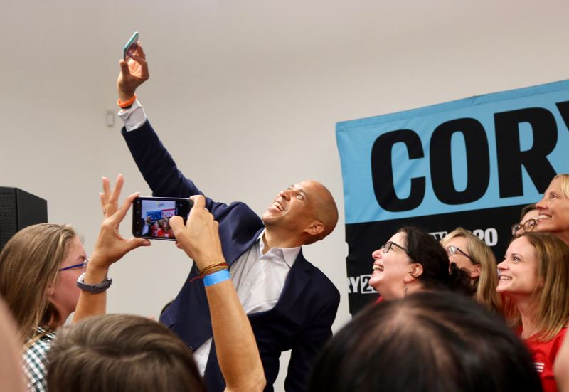 PMG PHOTO: ZANE SPARLING - Sen. Cory Booker was introduced to a Southeast Portland crowd on Sunday as a 'selfie professional.' He posed later with a local chapter of the gun control group Moms Demand Action.