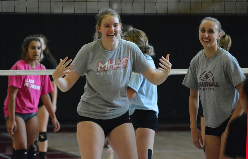 PMG PHOTO: DAVID BALL - Sandy teammates Kyra Child and Annika Noreen react after winning a point during a drill during last weeks tryouts.