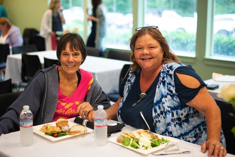 PMG PHOTO: ANNA DEL SAVIO - Sue B. and Shelly Kimball sit down for a meal at the recovery luncheon. Both have been in recovery for more than 15 years