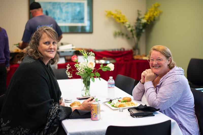 PMG PHOTO: ANNA DEL SAVIO - Columbia Community Mental Health clients and staff, some of whom have struggled with addiction themselves, gather on Wednesday to celebrate the hard work of recovery.