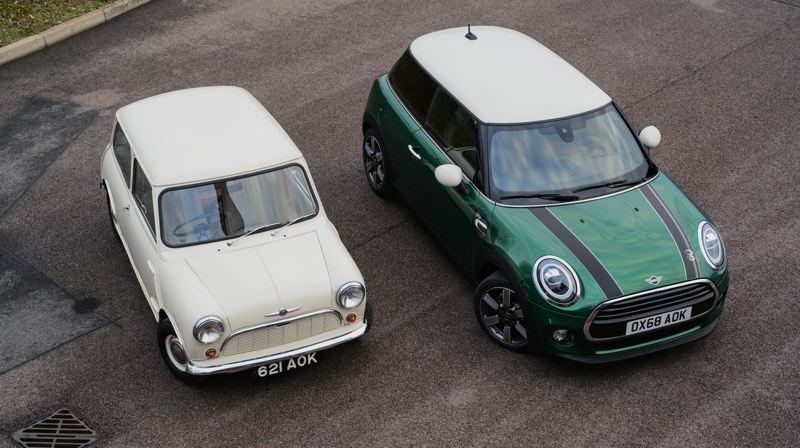 COURTESY MINI USA - A comparision of an original British Mini and a new one produced by BMW.