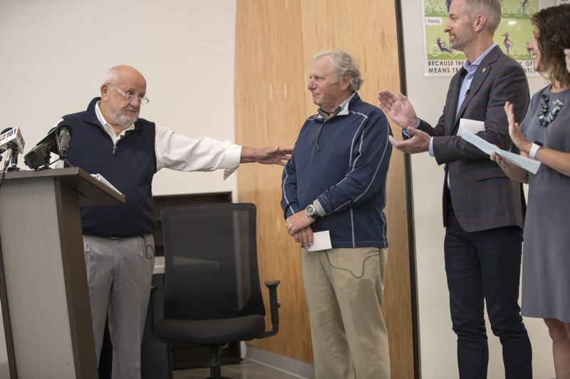PMG PHOTO: JAIME VALDEZ - Portland Developer Homer Williams recognizes Columbia Sportswear President and CEO Tim Boyle for his donation to the Navigation Center during the opening of the homeless shelter.