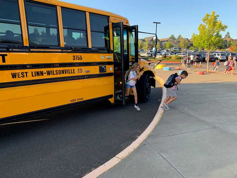 COURTESY PHOTO: ANDREW KILSTROM - Students exit the bus and head into Lowrie Primary for the first day of school.