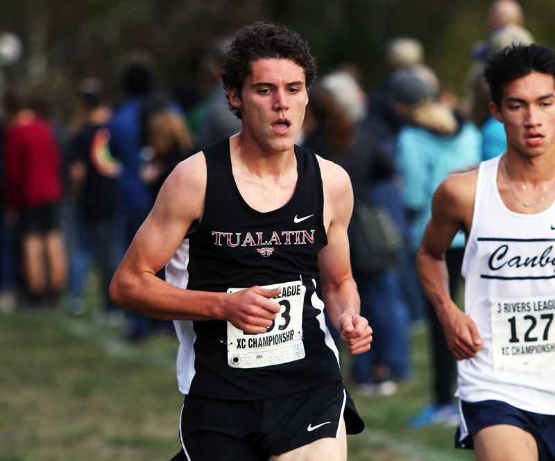 PMG FILE PHOTO: DAN BROOD - Eric Klein, now a Tualatin senior, helped the Wolves reach the state cross country meet last year, and followed that up with a strong track season.