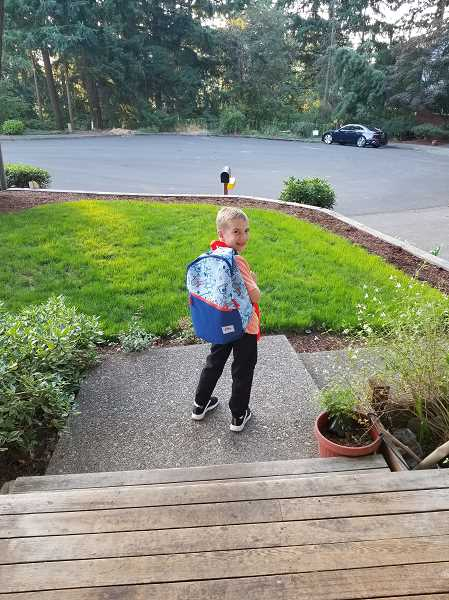COURTESY PHOTO - Boones Ferry third grader Sam Saunders leaves the house for the first day of school.