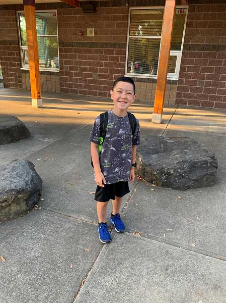 COURTESY PHOTO - Boones Ferry third grader Tenzin O'Neil arrives at school for his first day.
