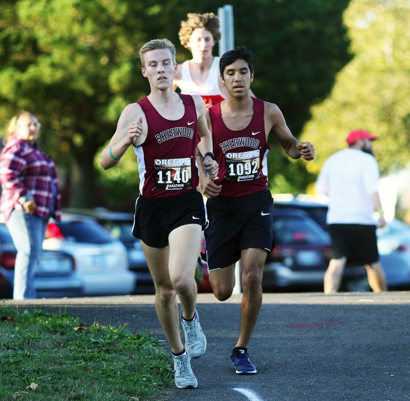 PMG FILE PHOTO: DAN BROOD - Sherwood senior Thomas Osborn (left) and junior Ismael Alvarez both return for the Bowmen cross country team this year.