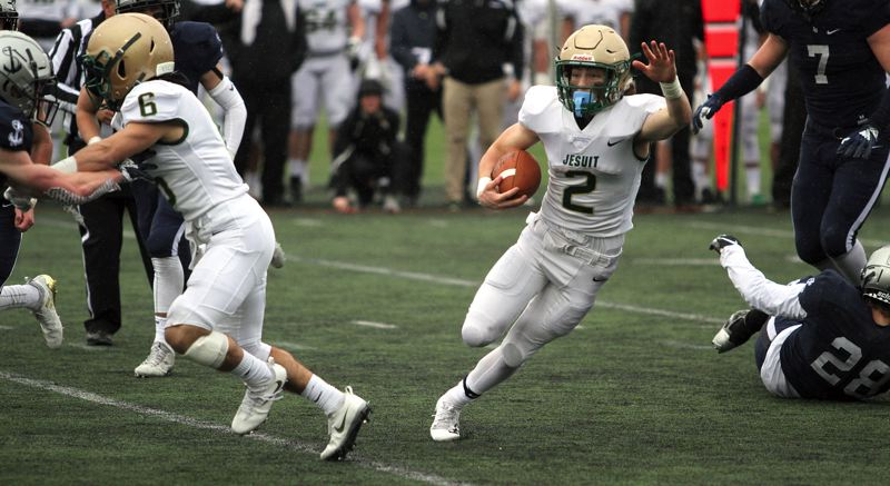 PMG PHOTO: MILES VANCE - Jesuit senior running back Kade Wisher and the Crusaders are ranked second in the first statewide Class 6A coaches poll of 2019.