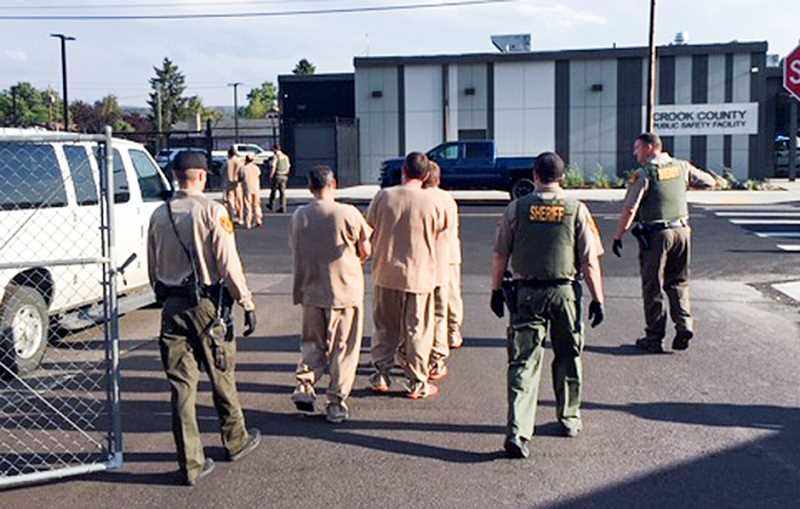 PHOTO COURTESY OF CROOK COUNTY SHERIFF'S OFFICE - The first inmates are moved from the old Crook County Jail to the new one in early August.