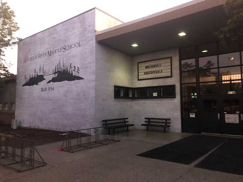 COURTESY PHOTO: LINDSAY TAYLOR - Jake and Lindsay Taylor spent hours painting the front of Molalla River Middle School to help spread a sense of school and community pride, finishing over the weekend of Aug. 24-25.