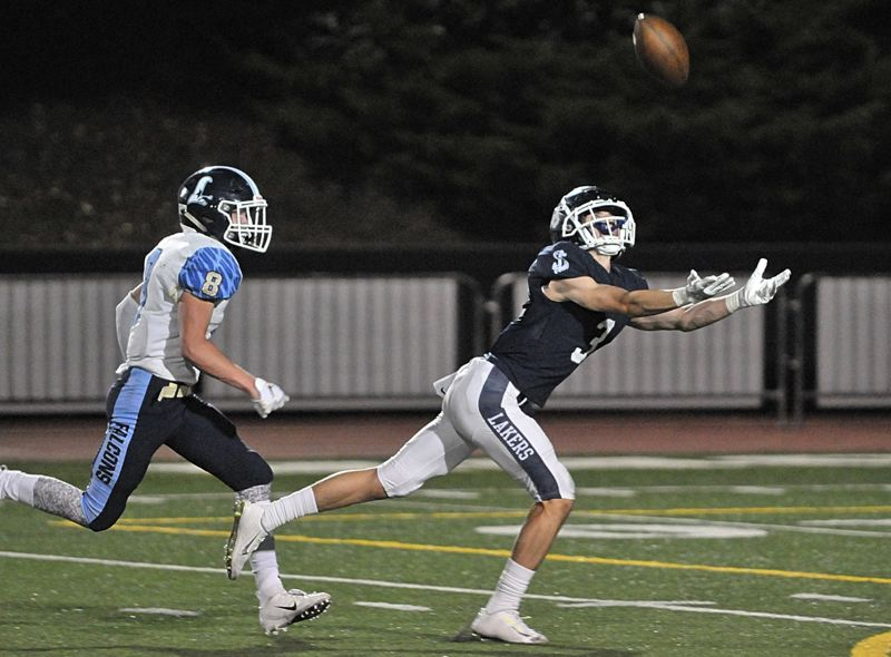 PMG PHOTO: MILES VANCE - Lake Oswego senior wide receiver Joe Hutson is back to make more circus catches and fuel the Laker offense in the upcoming football season.