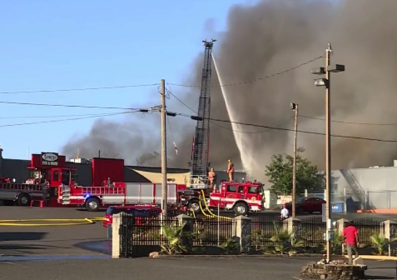 KOIN 6 NEWS - Firefighters battling the blaze Monday in Northeast Portland.