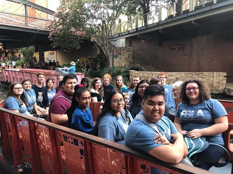 COURTESY PHOTO: KIEL MARTIN - Molalla FBLA members enjoy a river cruise in San Antonio, Texas during their visit for the National Leadership Conference last month.