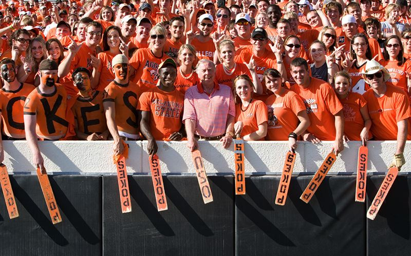 COURTESY: T. BOONE PICKENS - T. Boone Pickens, former chairman of BP Capital Management, mingles with Oklahoma State fans.