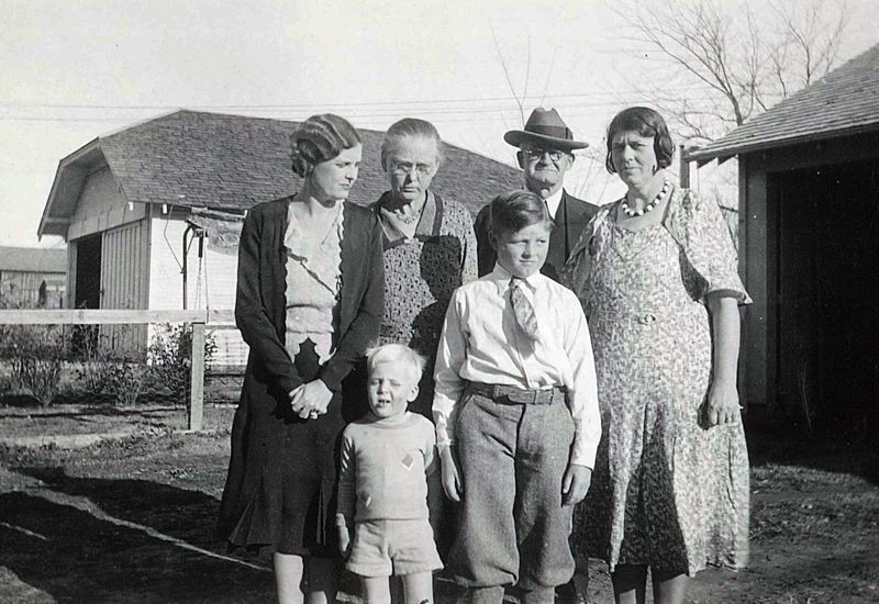 COURTESY: T. BOONE PICKENS - T. Boone Pickens (front row, left) poses with family members, including mother Grace Molonson Pickens (far left) in the early 1930s in Holdenville, Oklahoma.