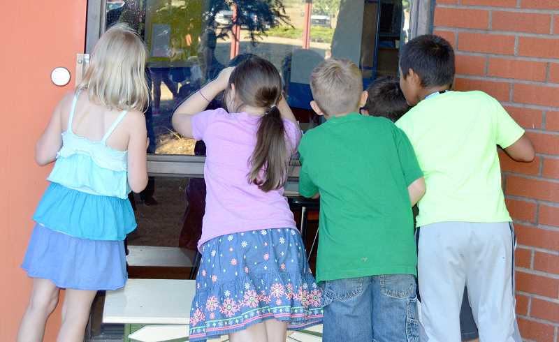 PMG FILE PHOTO: CINDY FAMA - Back in 2017, the school doors of Colton Elementary School couldn't open soon enough as these kids peeked through the window of their new classroom.
