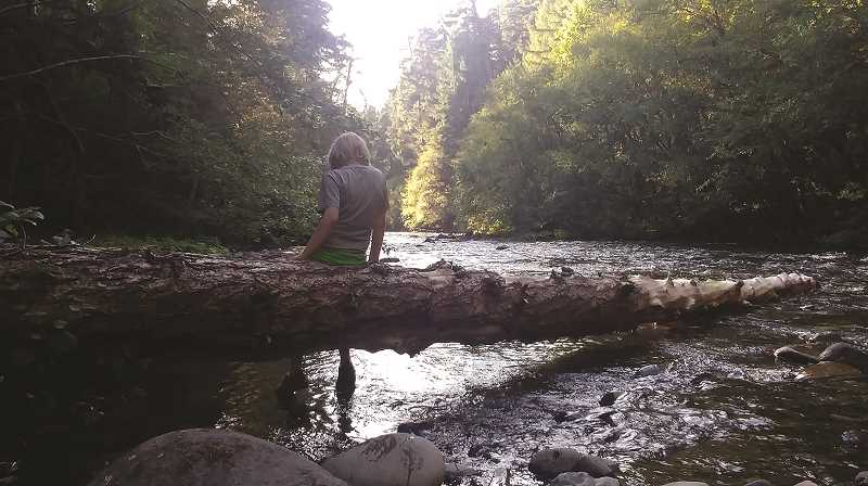 PMG PHOTOS: PHIL HAWKINS - The North Fork of the Willamette River is a cool place for a 9-year old to dip his toes in the water.