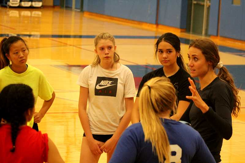 STEELE HAUGEN - New Madras head volleyball coach Natalie Villanueva talks to the team about the importance of love, encouragement, and support. Villanueva was a two-time state champion at Bend High School and played four years of volleyball at Southern Oregon University, in Ashland.