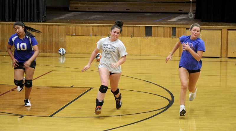 STEELE HAUGEN - Senior Janae Rhen (center),  junior Anyla Rico (left)  and sophomore Lucy Louden (right) run during the Lady Dawgs' practice. The two will be big pieces in this year's Culver volleyball sucess.