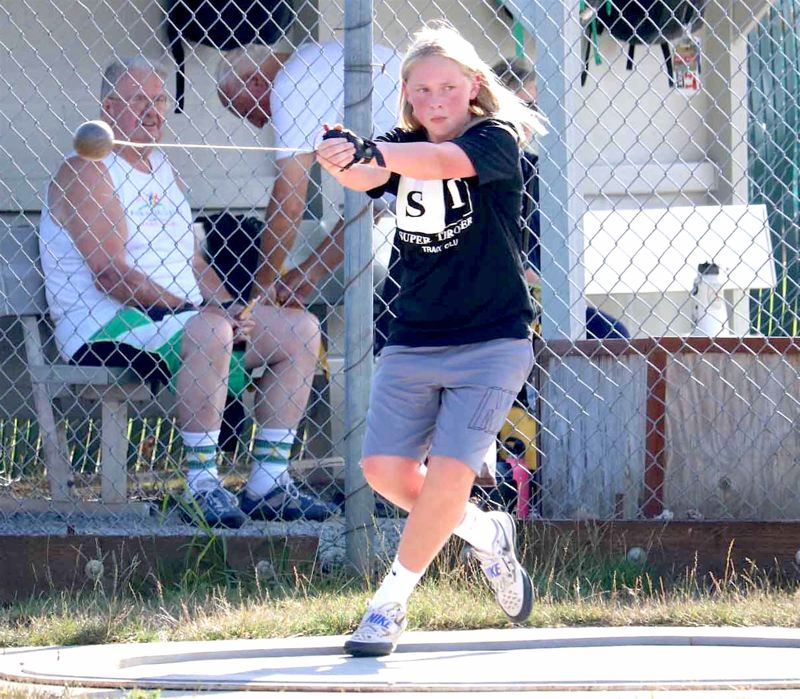 PMG PHOTO: JIM BESEDA - Madison Speer, of Hazelbrook Middle School, won the girls ages 13-14 hammer throw event at Friday's Super Throwers meet.